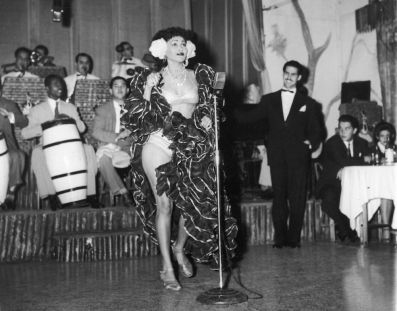 A-Cuban-rhumba-dancer-named-Zulema-performs-on-stage-with-a-band-at-the-Zombie-Club-on-Zulueta-Street-in-Havana.-1946
